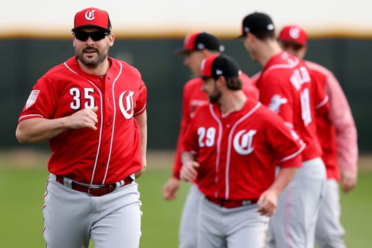 Cincinnati Reds pitchers Tanner Roark (35) warms up, Wednesday, Feb. 13, 2019, at the Cincinnati Reds spring training facility in Goodyear, Arizona.