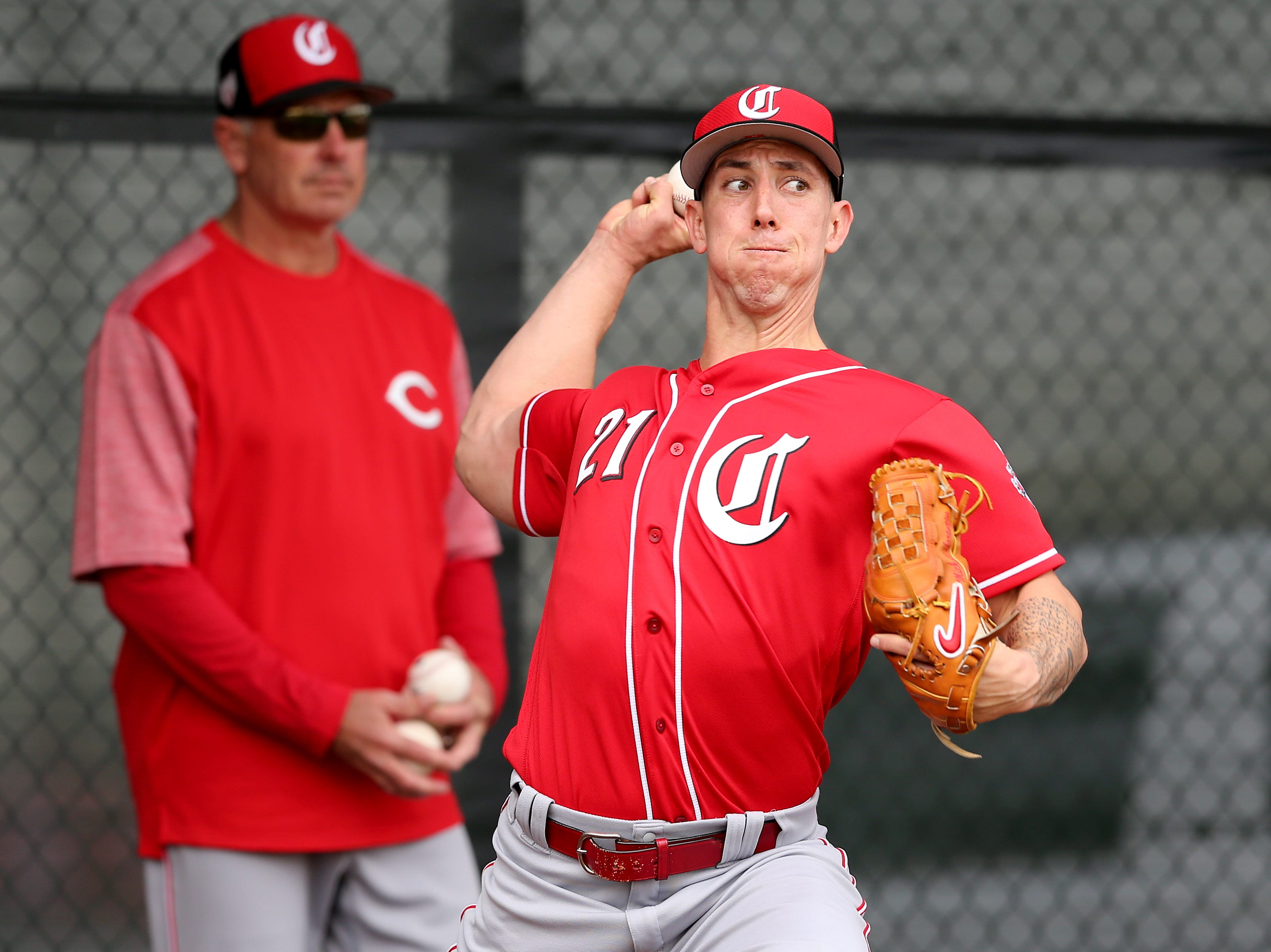 Cincinnati Reds relief pitcher Michael Lorenzen (21) delivers during a bullpen session, Wednesday, Feb. 13, 2019, at the Cincinnati Reds spring training facility in Goodyear, Arizona.