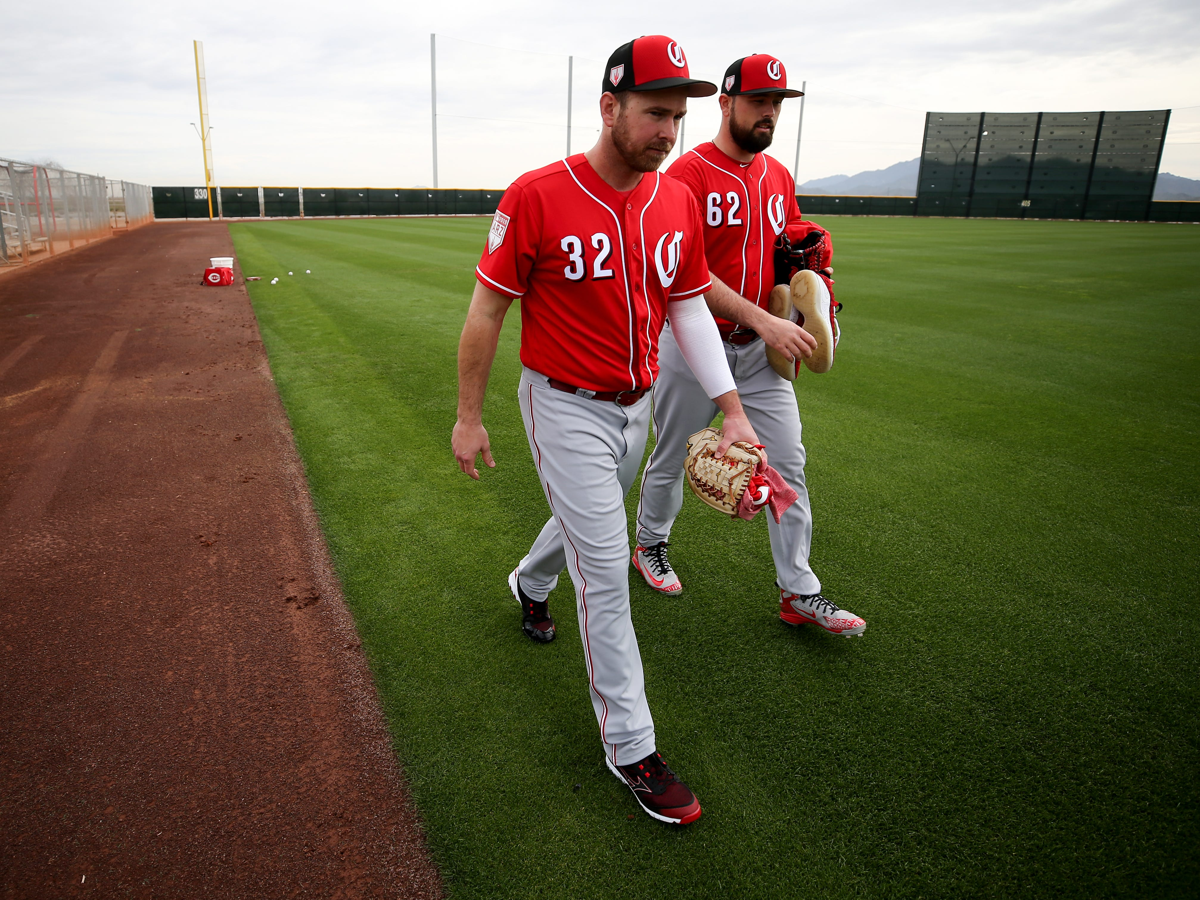 Cincinnati Reds relief pitcher Zach Duke (32), left, and Cincinnati Reds relief pitcher Jackson Stephens (62) walk off the field after long-toss drills, Wednesday, Feb. 13, 2019, at the Cincinnati Reds spring training facility in Goodyear, Arizona.