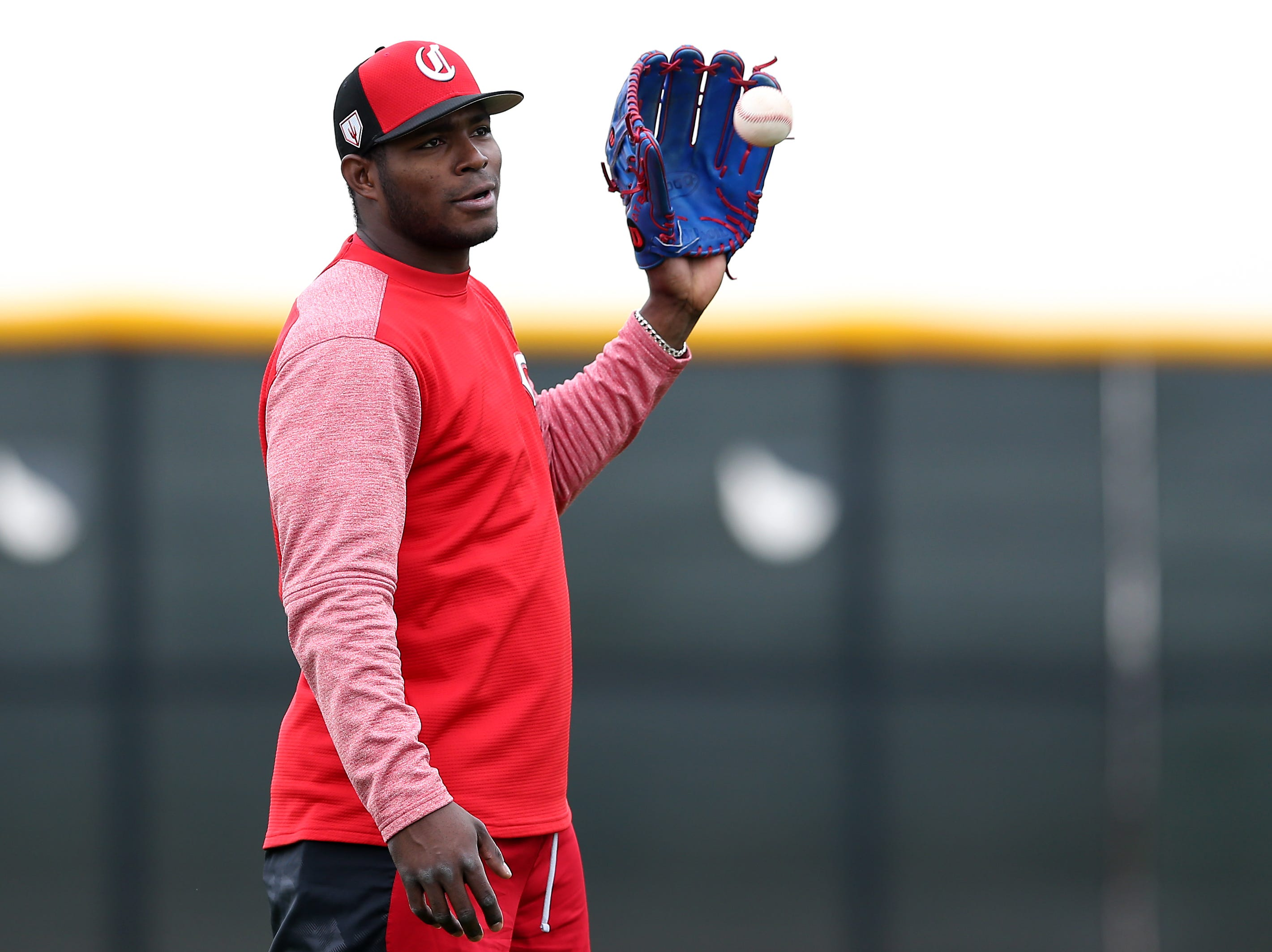 Cincinnati Reds outfielder Yasiel Puig (66) catches a ball during drills, Wednesday, Feb. 13, 2019, at the Cincinnati Reds spring training facility in Goodyear, Arizona.