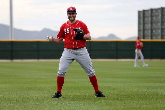 Cincinnati Reds pitcher Tanner Roark (35) smiles during long-toss drills, Wednesday, Feb. 13, 2019, at the Cincinnati Reds spring training facility in Goodyear, Arizona.
