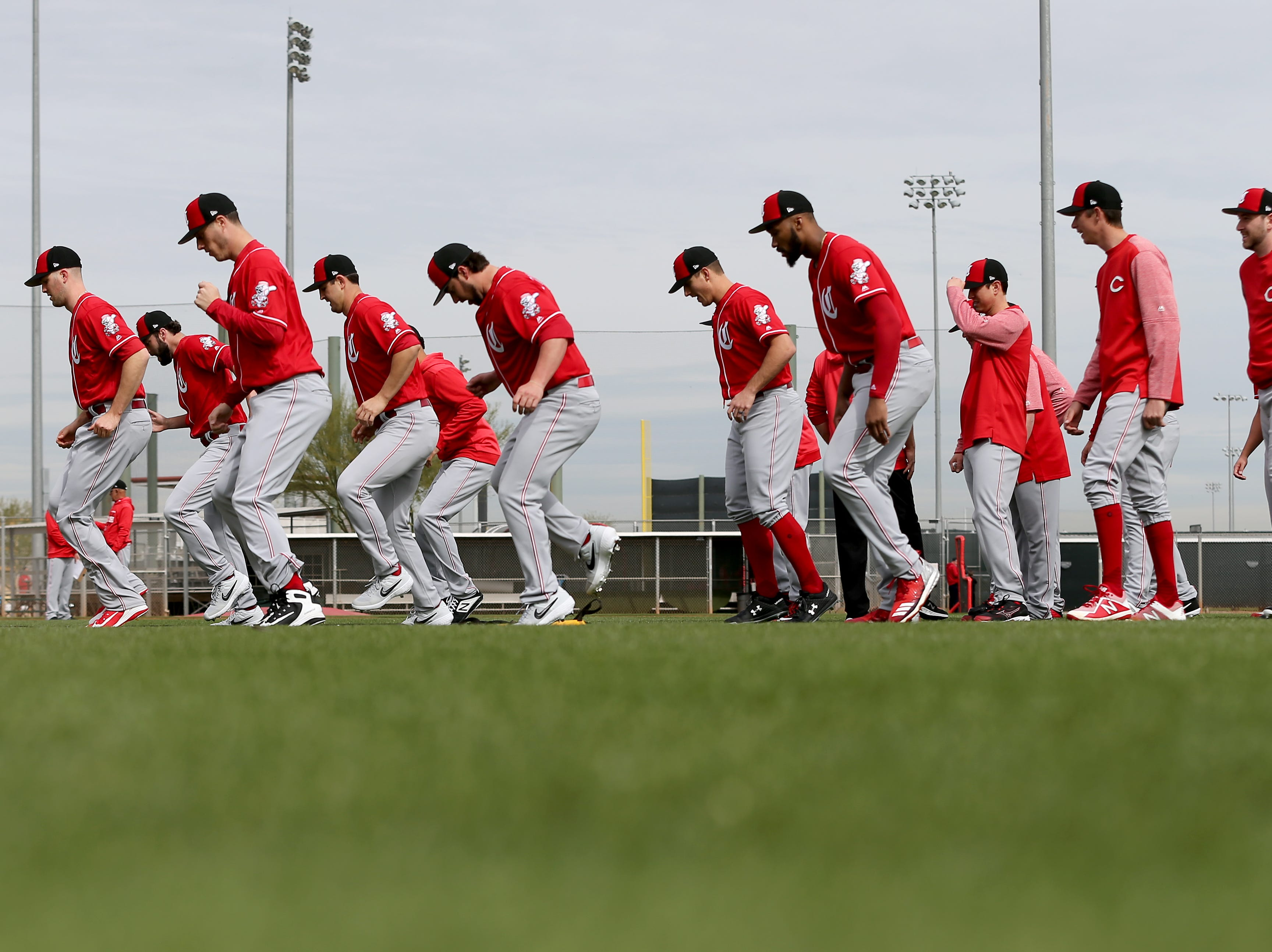 Cincinnati Reds pitchers warm up on the first day of workouts, Wednesday, Feb. 13, 2019, at the Cincinnati Reds spring training facility in Goodyear, Arizona.