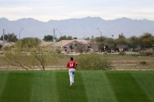 Cincinnati Reds relief pitcher Amir Garrett (50) runs up a conditioning hill, Wednesday, Feb. 13, 2019, at the Cincinnati Reds spring training facility in Goodyear, Arizona.