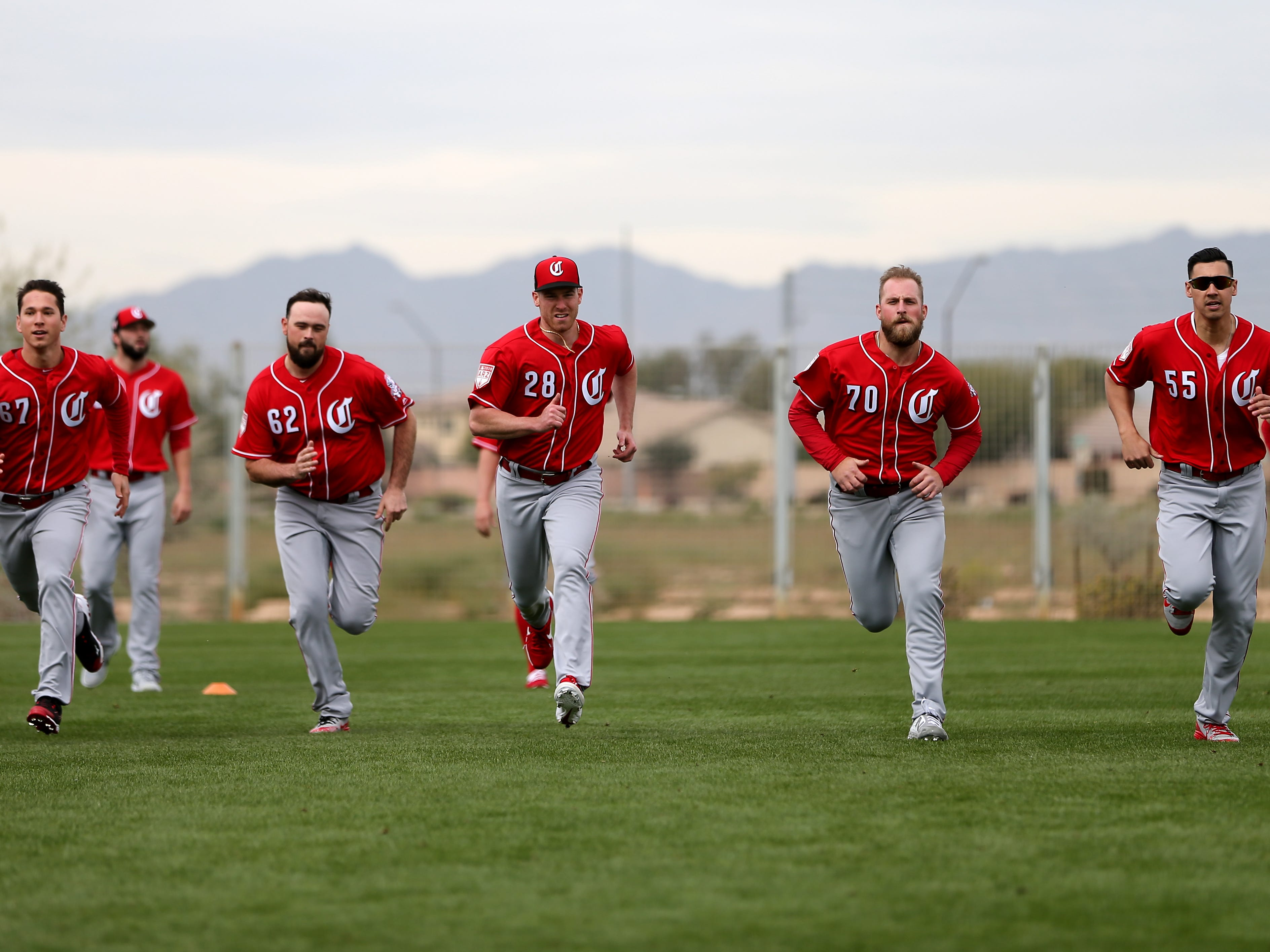 From left: Cincinnati Reds pitchers Matt Bowman, Jackson Stephens (62), Anthony DeSclafani (28), Ian Krol (70) and Robert Stephenson (55) run sprints, Wednesday, Feb. 13, 2019, at the Cincinnati Reds spring training facility in Goodyear, Arizona.