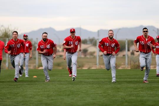 From left: Cincinnati Reds pitchers Matt Bowman, Jackson Stephens (62), Anthony DeSclafani (28), Ian Krol (70) and Robert Stephenson (55) run sprints, Wednesday, Feb. 13, 2019, at the Cincinnati Reds spring training facility in Goodyear, Arizona.