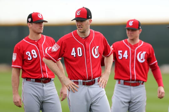 Cincinnati Reds pitchers Lucas Sims (39), Alex Wood (40) and Sonny Gray (54) warm up, Wednesday, Feb. 13, 2019, at the Cincinnati Reds spring training facility in Goodyear, Arizona.