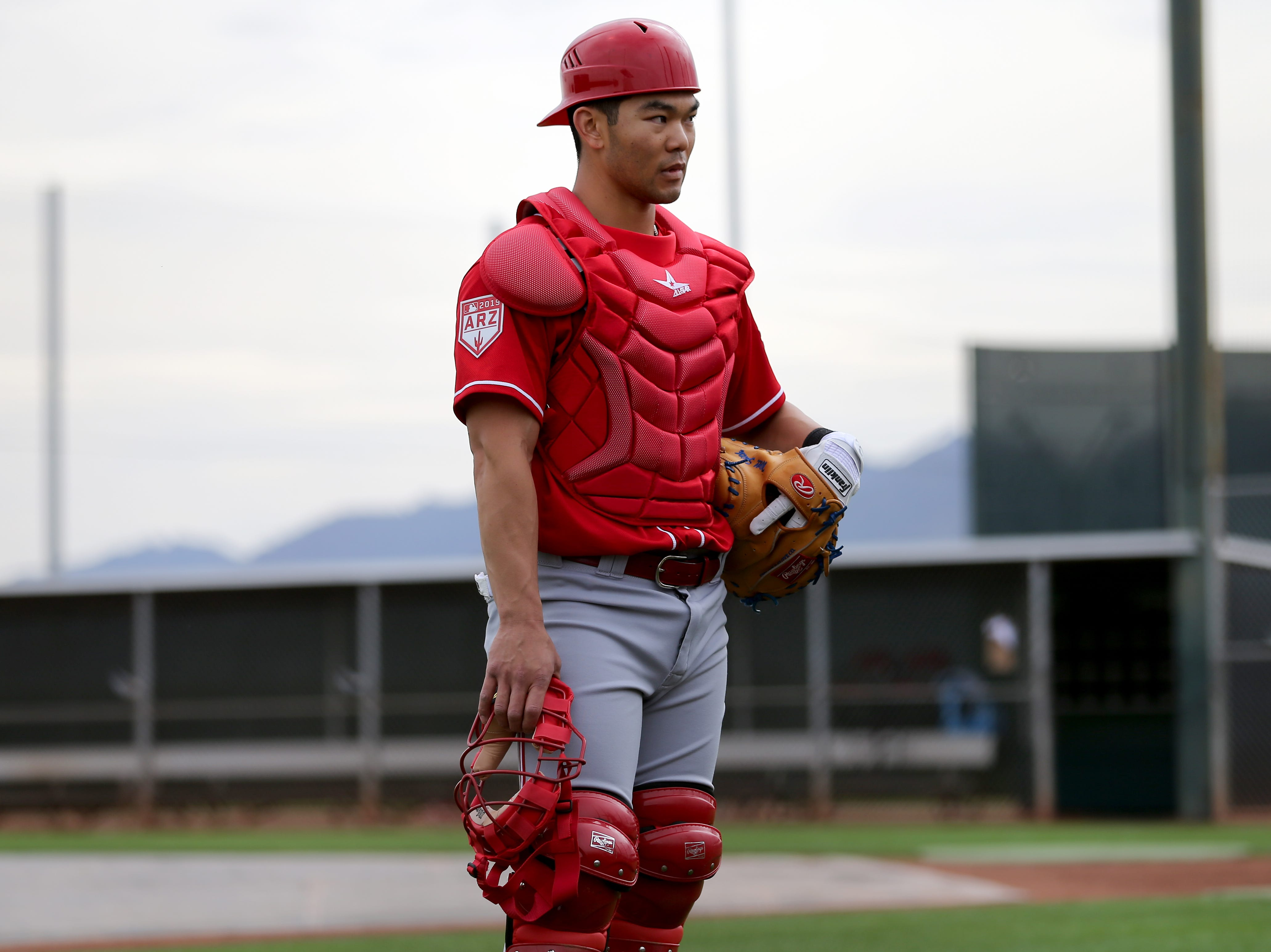 Cincinnati Reds catcher Joe Connor (17) waits his turn during drills, Wednesday, Feb. 13, 2019, at the Cincinnati Reds spring training facility in Goodyear, Arizona.