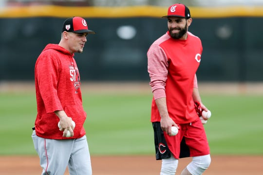Cincinnati Reds second baseman Scooter Gennett (3), left, and Cincinnati Reds second baseman Jose Peraza (9) work out, Wednesday, Feb. 13, 2019, at the Cincinnati Reds spring training facility in Goodyear, Arizona.