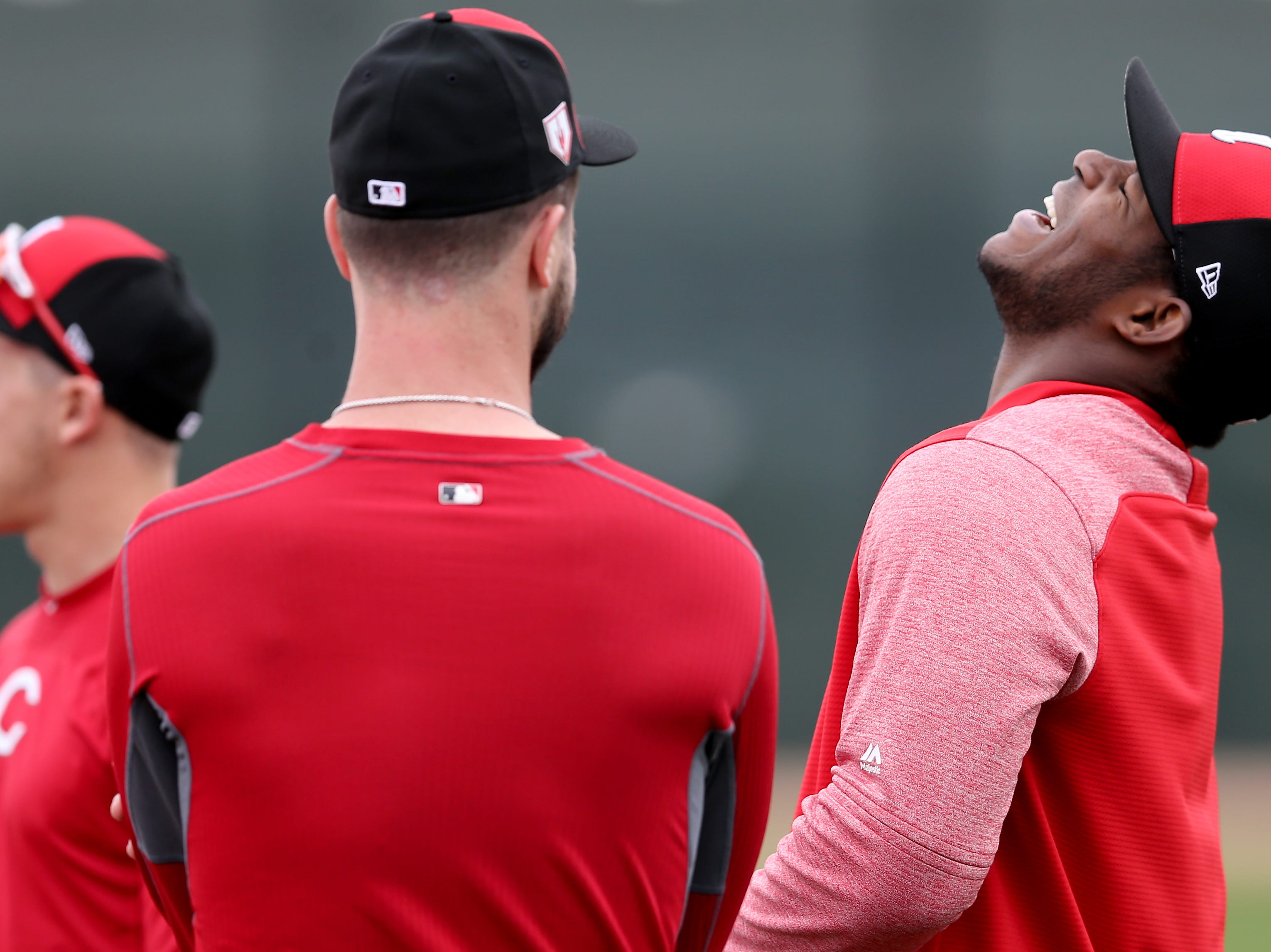 Cincinnati Reds outfielder Yasiel Puig (66), right, laughs at a joke by Cincinnati Reds right fielder Jesse Winker (33), Wednesday, Feb. 13, 2019, at the Cincinnati Reds spring training facility in Goodyear, Arizona.