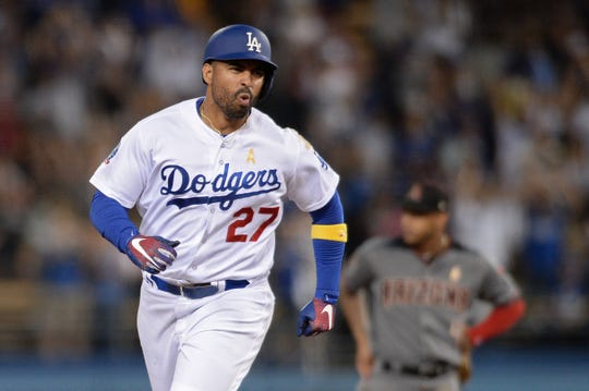 Sep 1, 2018; Los Angeles, CA, USA; Los Angeles Dodgers left fielder Matt Kemp (27) reacts as he rounds the bases after hitting a three-run home run during the eighth inning as Arizona Diamondbacks second baseman Ketel Marte (4) looks on at Dodger Stadium. Mandatory Credit: Orlando Ramirez-USA TODAY Sports