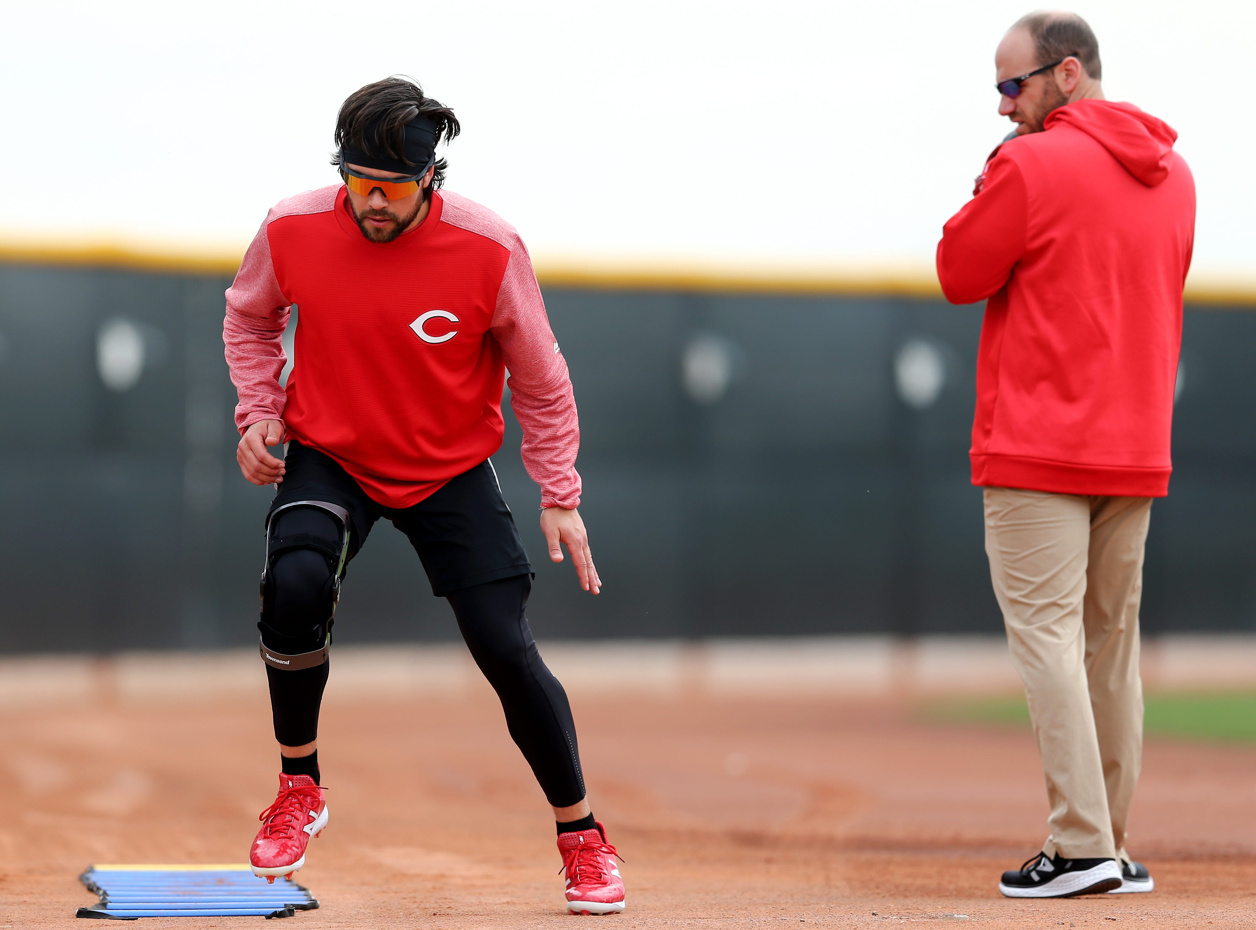 Cincinnati Reds shortstop Alex Blandino (2) works out on the side after suffering a season-ending injury in 2018, Wednesday, Feb. 13, 2019, at the Cincinnati Reds spring training facility in Goodyear, Arizona.