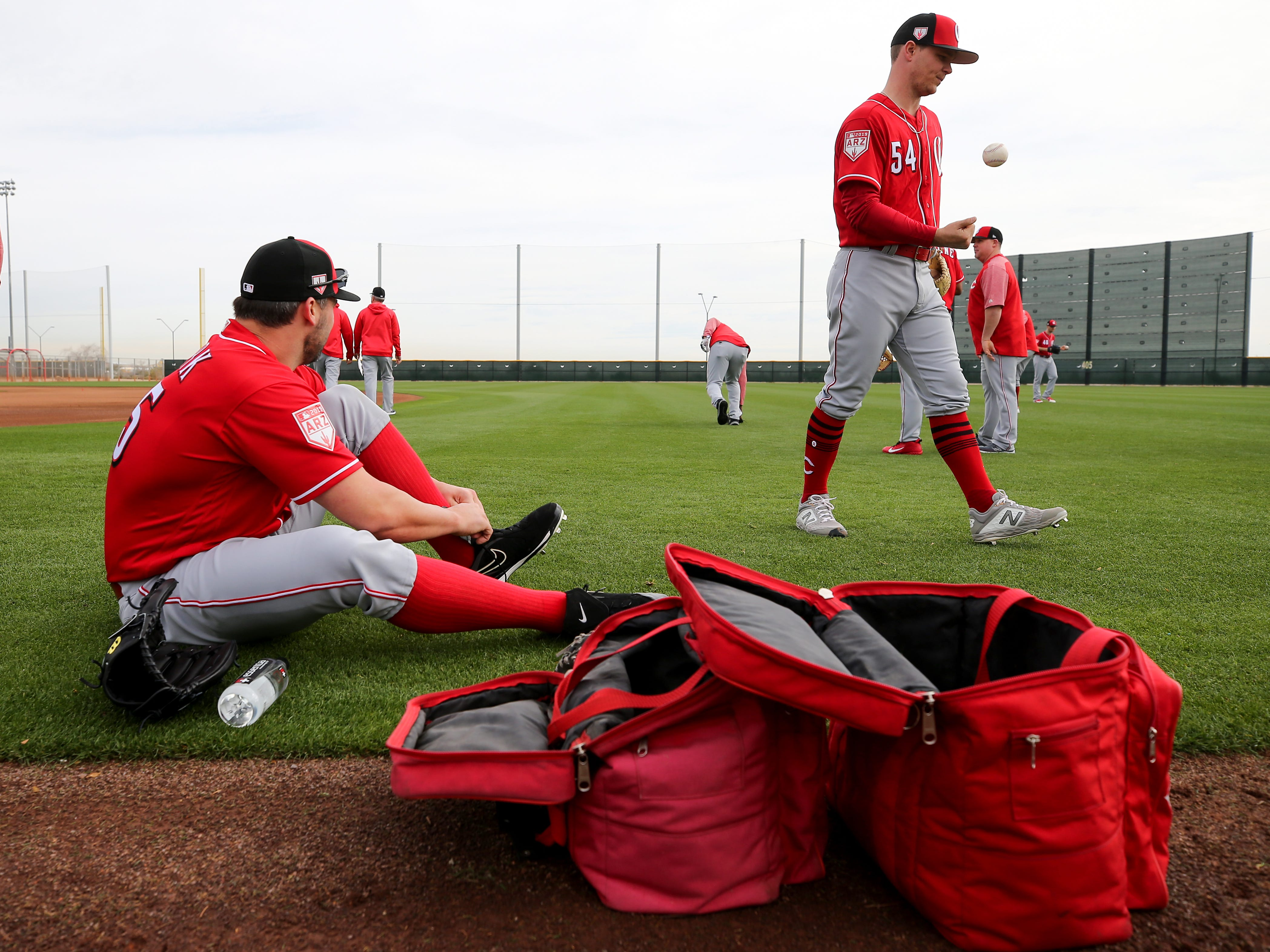 Cincinnati Reds pitcher Tanner Roark (35), left, and Cincinnati Reds starting pitcher Sonny Gray (54) right, warm up, Wednesday, Feb. 13, 2019, at the Cincinnati Reds spring training facility in Goodyear, Arizona.