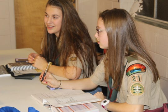 Gabby Kowalski and Bella Doyle lead a meeting of Clarksville's first all-girl Scout BSA Troop 21 on February 12, 2019.