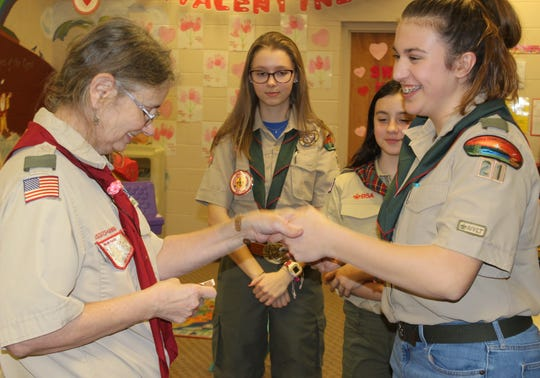 Bella Doyle receives her first merit badges as an official member of Scout BSA Troop 21 at their meeting on February 12, 2019.