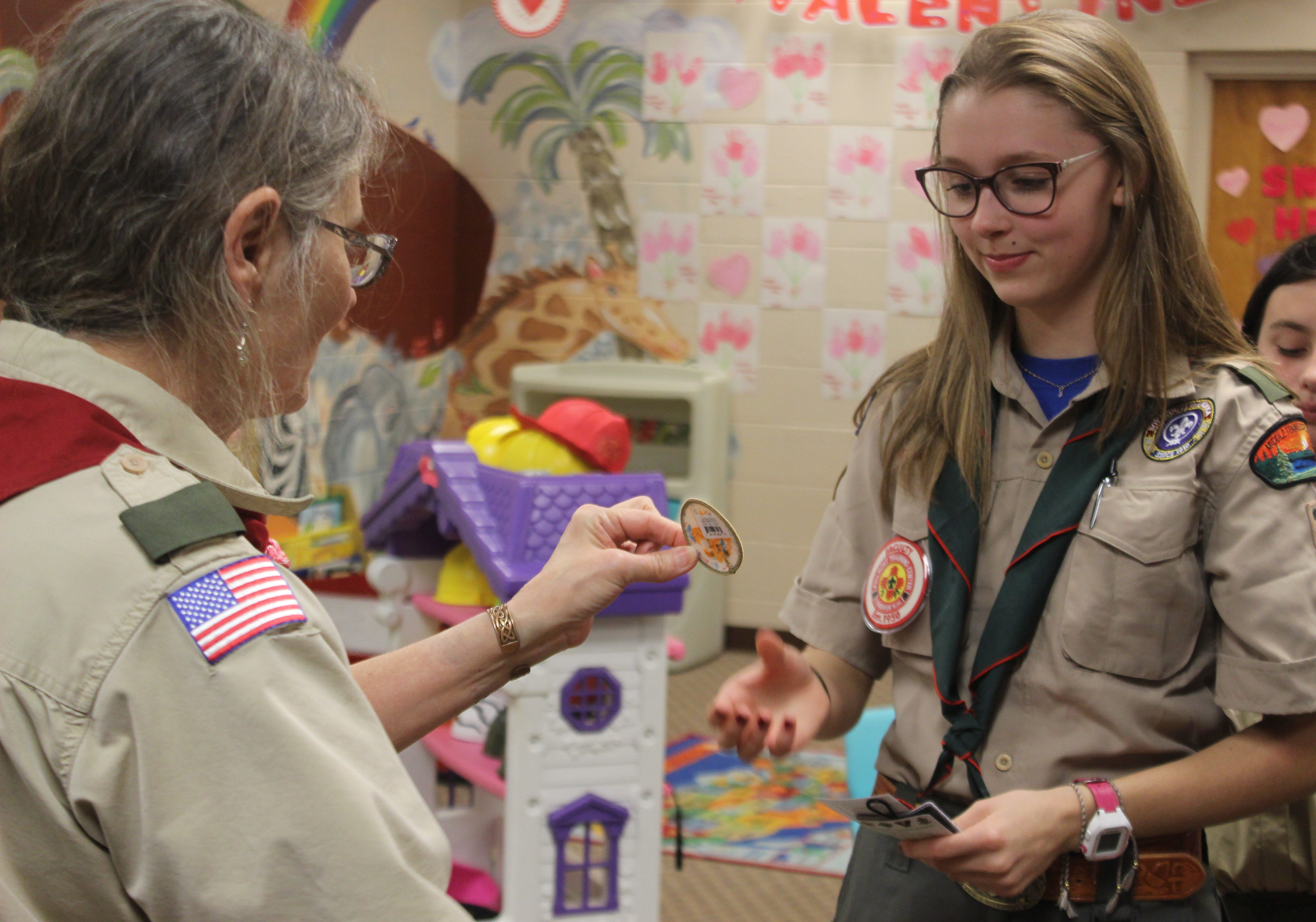 Gabby Kowalski receives a merit badge signifying completion of her first rank as an official member of Scout BSA Troop 21 on February 12, 2019.
