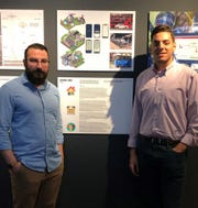"Kean University's Industrial Design Coordinator Efecem Kutuk, left, and student James D'Orazio of Wyckoff, right, stand by the project, ""A Day in the Life of Kean University,"" which is being exhibited at the Cooper Hewitt, Smithsonian Museum in New York City. A team of four Kean students created the project."