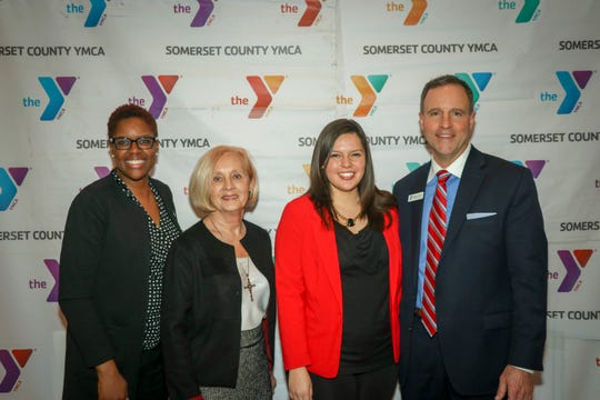 Somerset County Freeholders Patricia Walsh, Shanel Robinson andSarah Sooy with Somerset County YMCA President and CEO David M. Carcieri.