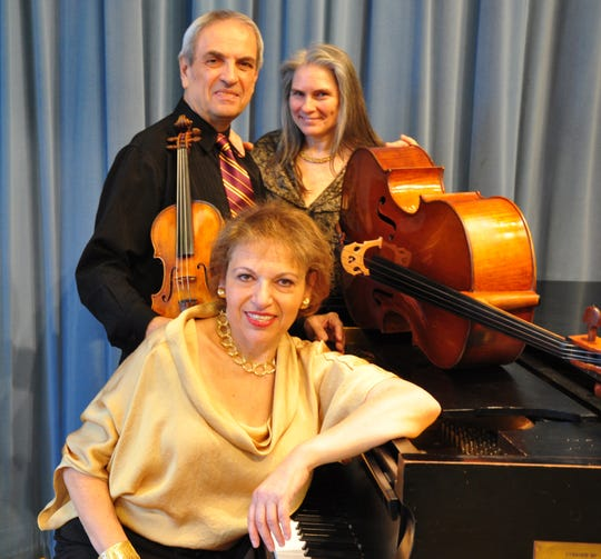 The Arcadian Trio, featuring (front) pianist Diane Goldsmith, (in back) violinist Igor Szwec and cellist Vivian Barton Dozor.