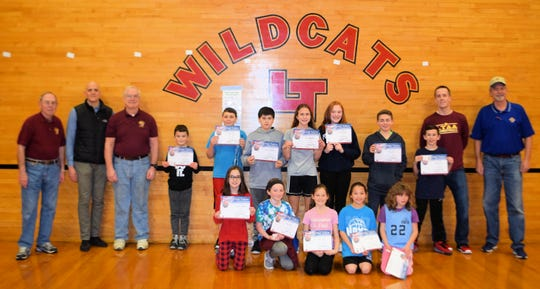 Back row holding certificates (left to right): Lucas Benitez, Tristan Egan, Jason Morales, Nora Stashefski, Eliza Truempy, Owen Pierro and Joey Gardner. Front row: Camryn Valenta, Cordelia Cahill (shoot-out finalist), Siobhan Devine, Kayla Appicelli and Scarlet Borchin (shoot-out finalist). With them are High Bridge Knights Don Branflick, Mark Kucharski, Steve Bauernfeind, Chris Denis and Kevin Loughney. Not pictured are shoot-out finalist Faye Austin and champions Maansi Patel and Joe Furka.