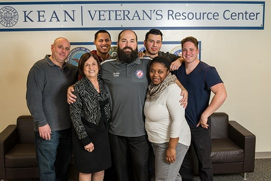 Mentors in the Kean University Office of Veteran Student Services, veterans themselves, work one-on-one with student veterans to ease the transition to student life. (Front row, left to right): Patti Martino, executive secretary to Kean's president; Vito Zajda, director of Veteran Student Services; and mentor Venus Everett. (Back row, left to right): Mentors Daniel Colangelo, Louis Espinal, Matthew Diaz, and Juan Leon-Torres.