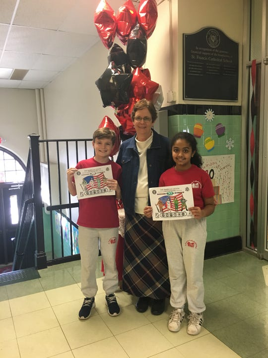 Congratulations to St. Francis Cathedral School (SFCS) students who placed 2nd and 3rd in the 4th and 5th Grade American Legion Post 65 Coloring Contest. (Left to right)Dylan Patterson, Principal Ann Major and Diya Sachdeva. SFCS is in Metuchen and educates students from Pre-K to 8th grade.