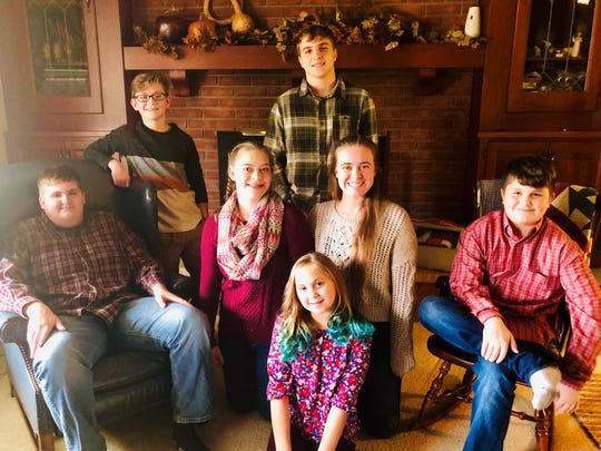 Ava Winner, center, shows her with her cousins and siblings on Thanksgiving, before she brain tumor was discovered. In the middle are Ava's brother Brady Winner, cousins Sophie and Maddy Meiser and brother Ashton Winner. In the back are cousin Lucas Meiser and brother Brendan Shrimplin.