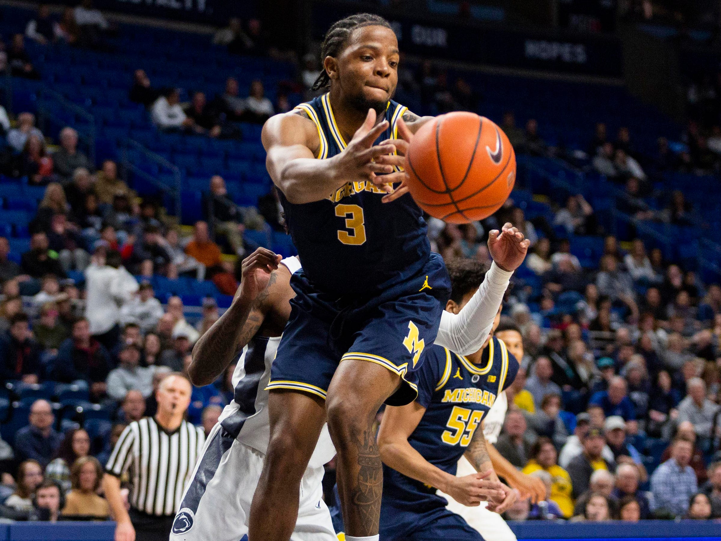 Michigan guard Zavier Simpson attempts to grab a rebound during the first half against Penn State, Tuesday, Feb. 12, 2019, in State College, Pa.