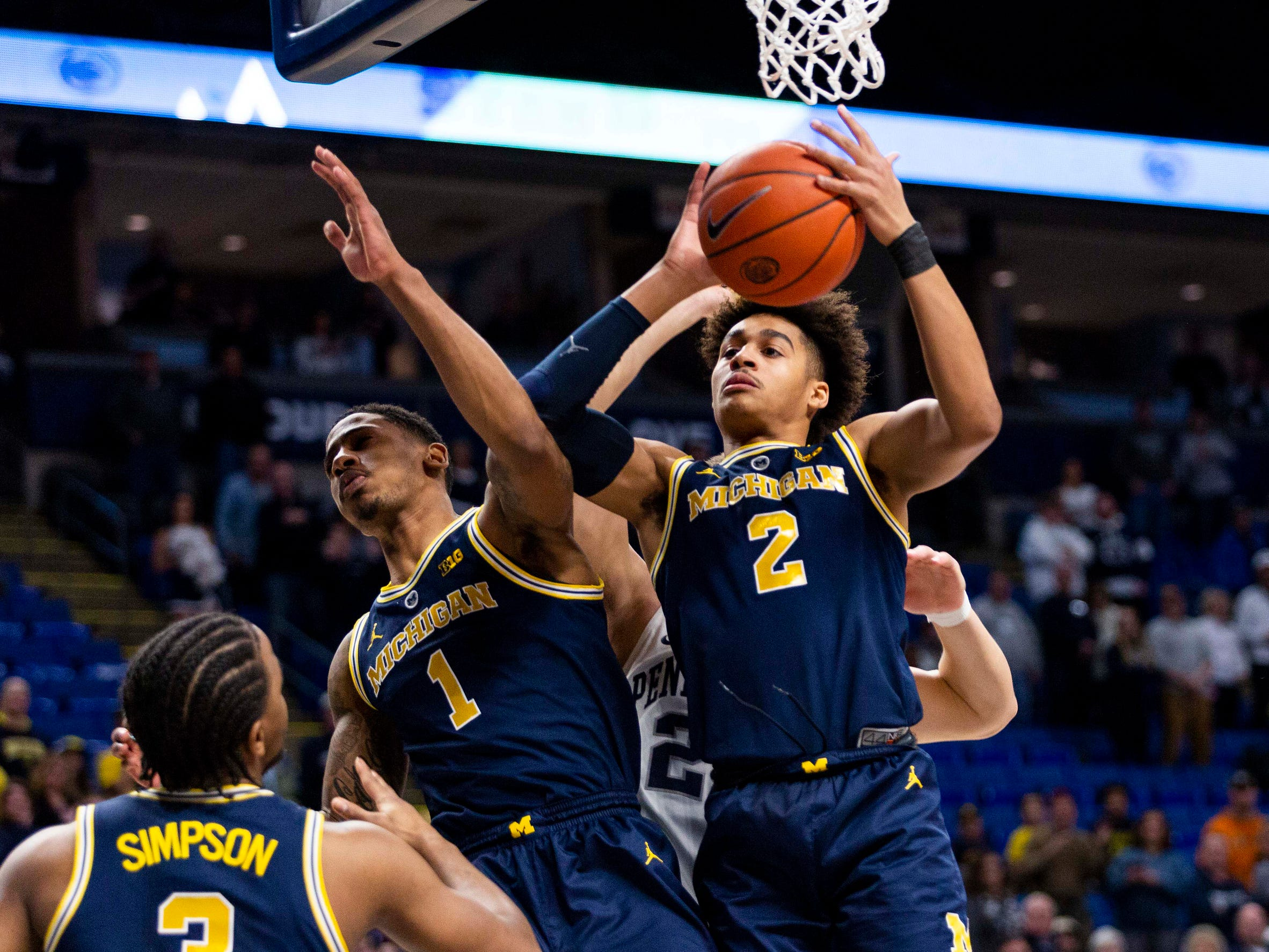 Michigan's Jordan Poole (2) rebounds during the first half against Penn State at Bryce Jordan Center, Tuesday, Feb. 12, 2019, in State College, Pa.