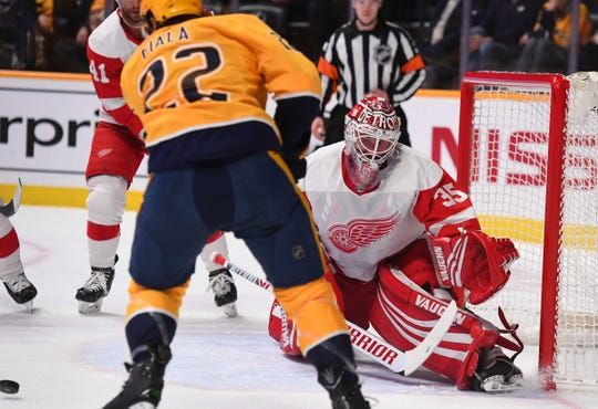 Jimmy Howard makes a save on a shot by Predators left wing Kevin Fiala during the first period Tuesday.