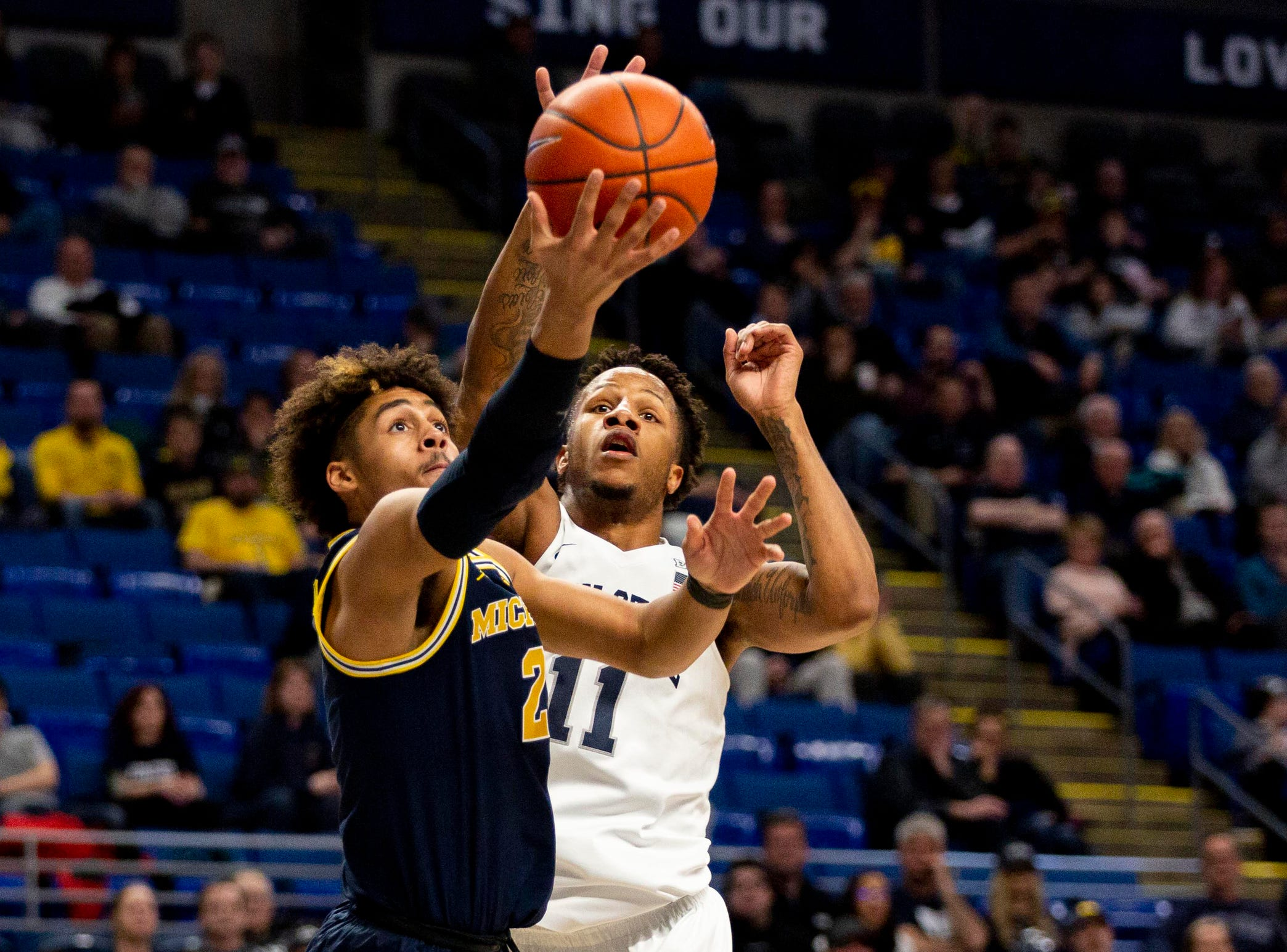 Michigan guard Jordan Poole shoots the ball past Penn State forward Lamar Stevens during the second half of U-M's 75-69 loss on Tuesday, Feb. 12, 2019, in State College, Pa.