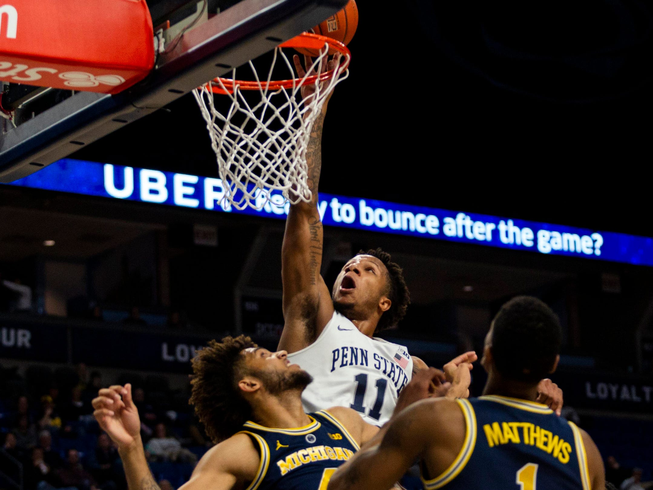 Penn State's Lamar Stevens shoots over Michigan's Isaiah Livers during the first half Tuesday, Feb. 12, 2019, in State College, Pa.