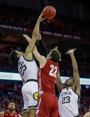 Kenny Goins blocks a shot by Ethan Happ during the second half.
