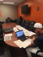 Joe Vavra, the Detroit Tigers' quality control coach, works on finalizing the team's spring training workout plans on Monday.