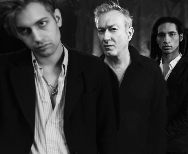 "Andy Gill, center, with his band mates. Gang of Four is on tour promoting the soon-to-be-released album ""Happy Now."""