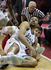 Kenny Goins wrestles for the ball against Wisconsin's Ethan Happ in the second half Tuesday in Madison, Wis.