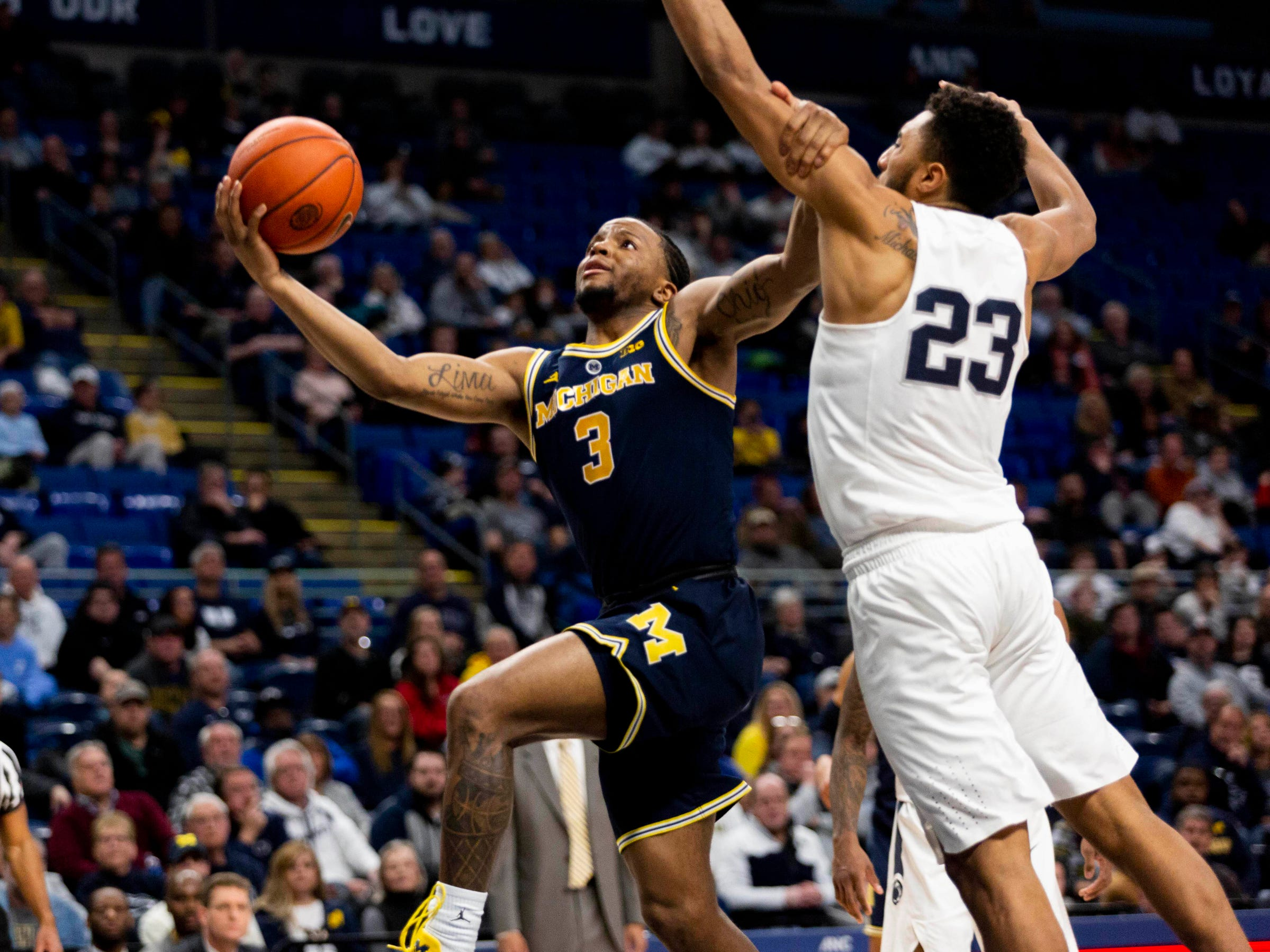 Michigan guard Zavier Simpson shoots past Penn State guard Josh Reaves during the second half Tuesday, Feb. 12, 2019, in State College, Pa.