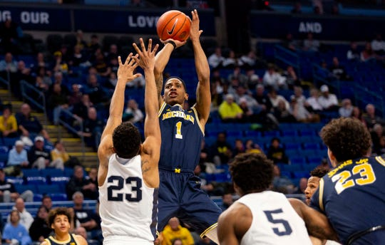 Michigan guard Charles Matthews shoots over Penn State guard Josh Reaves during the second half Tuesday, Feb. 12, 2019, in State College, Pa.