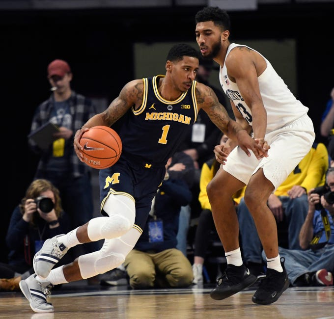Michigan guard Charles Matthews tries to get around Penn State guard Josh Reaves during the second half of U-M's 75-69 loss on Tuesday, Feb. 12, 2019, in State College, Pa.
