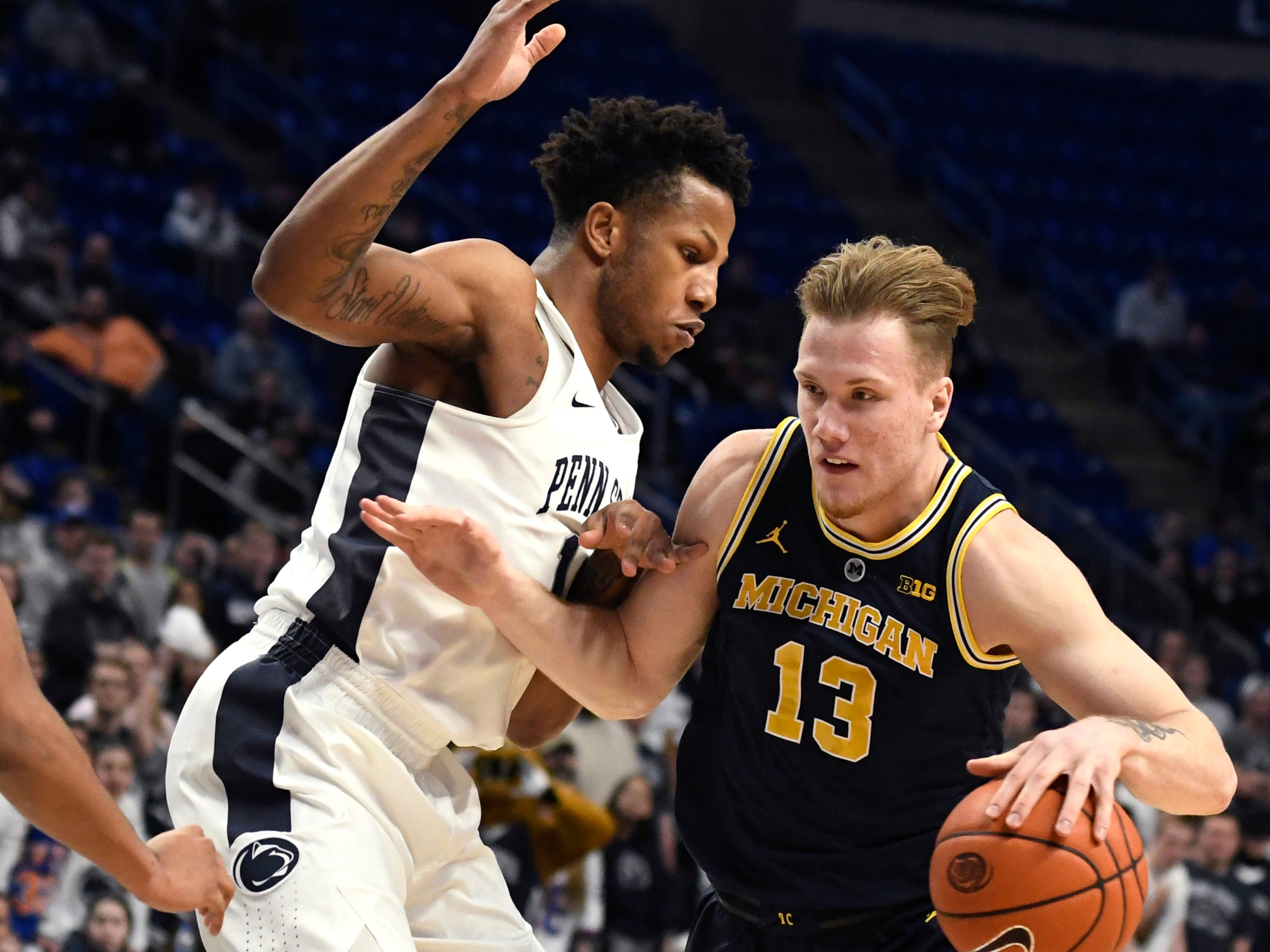 Michigan forward Ignas Brazdeikis dribbles around Penn State forward Lamar Stevens during the first half Tuesday, Feb. 12, 2019, in State College, Pa.