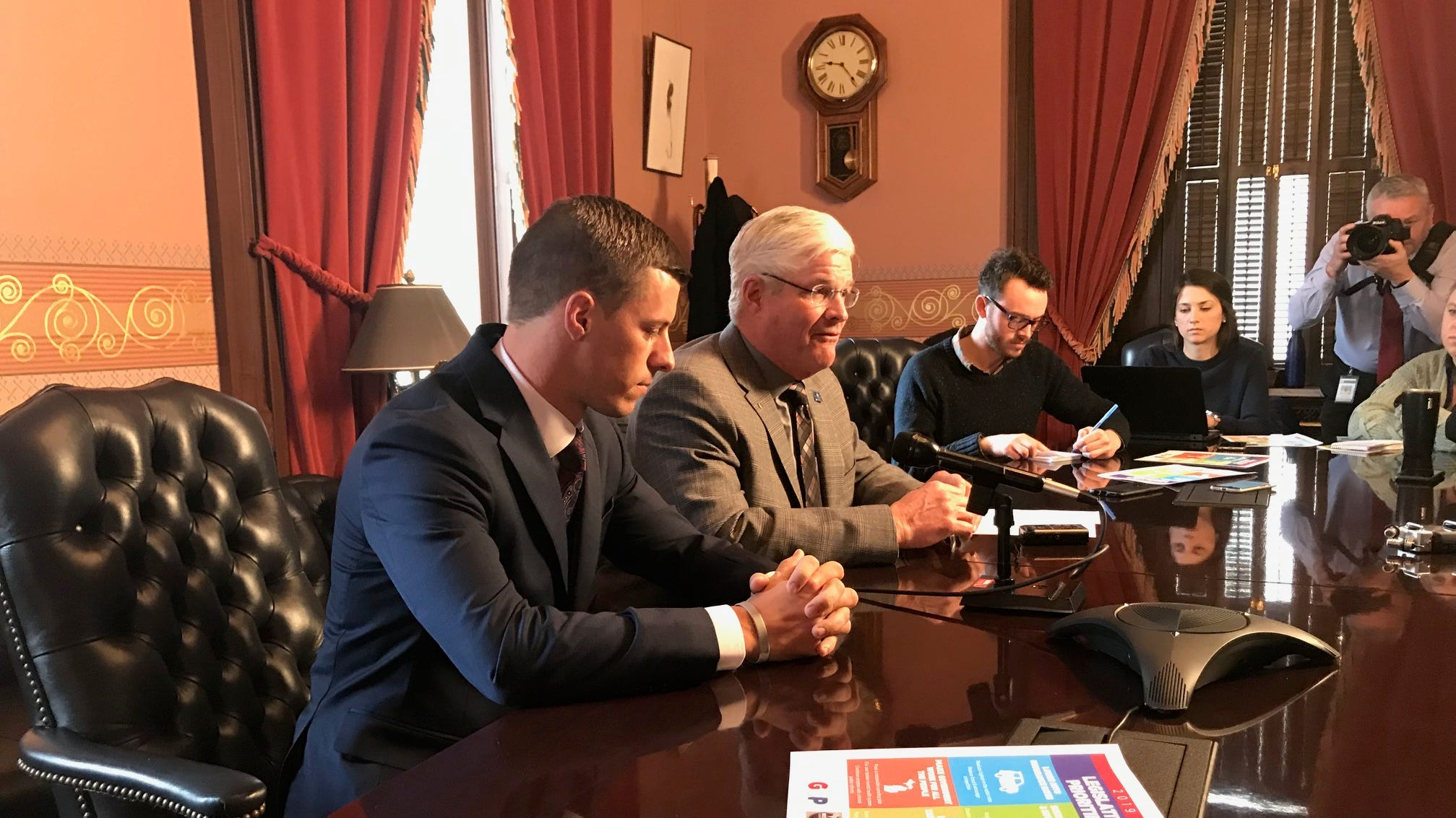 House Speaker Lee Chatfield (left) and Senate Majority Leader Mike Shirkey react Wednesday to Gov. Gretchen Whitmer's State of the State address.