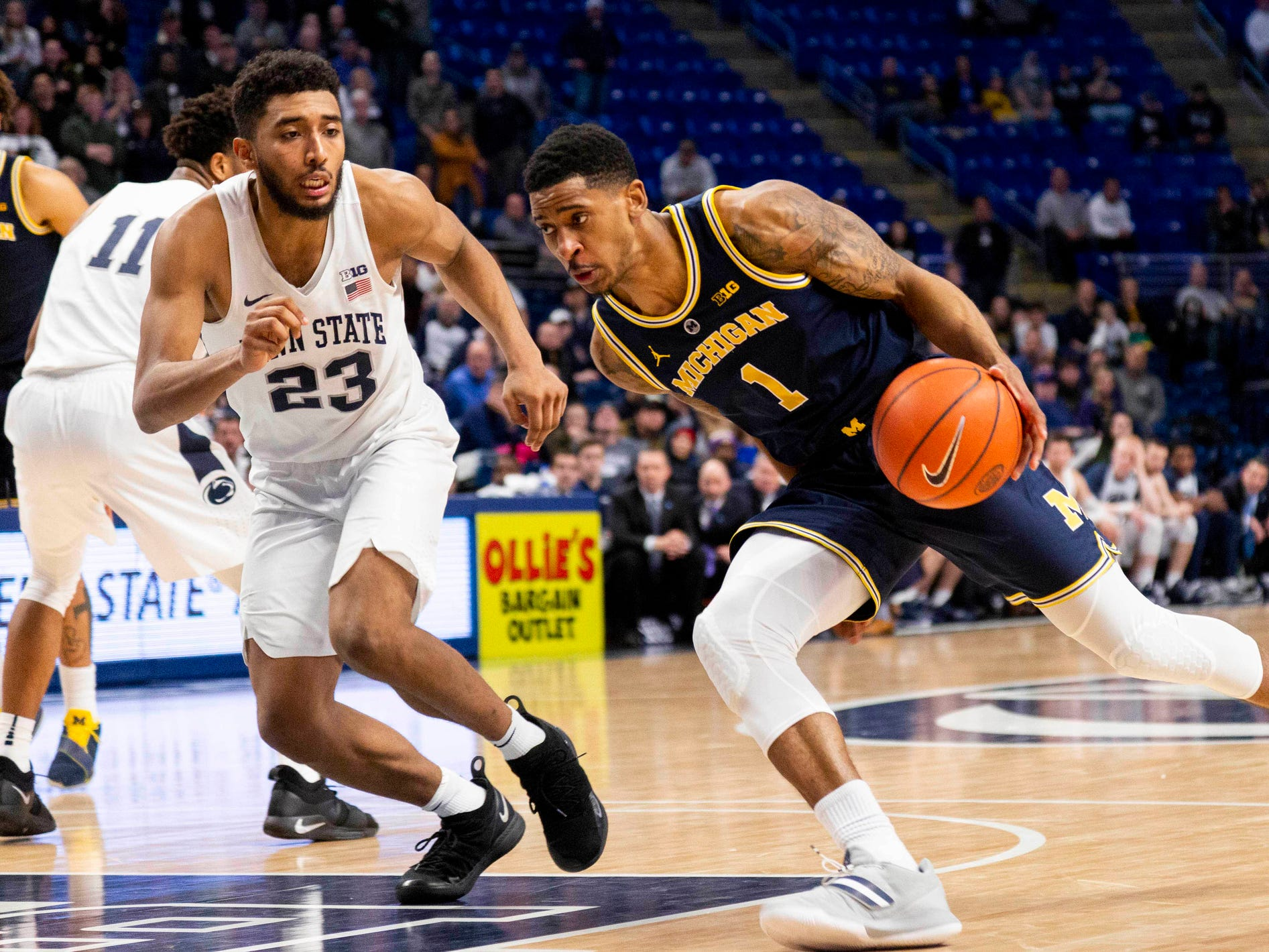 Michigan guard Charles Matthews dribbles around Penn State guard Josh Reaves during the second half Tuesday, Feb. 12, 2019, in State College, Pa.