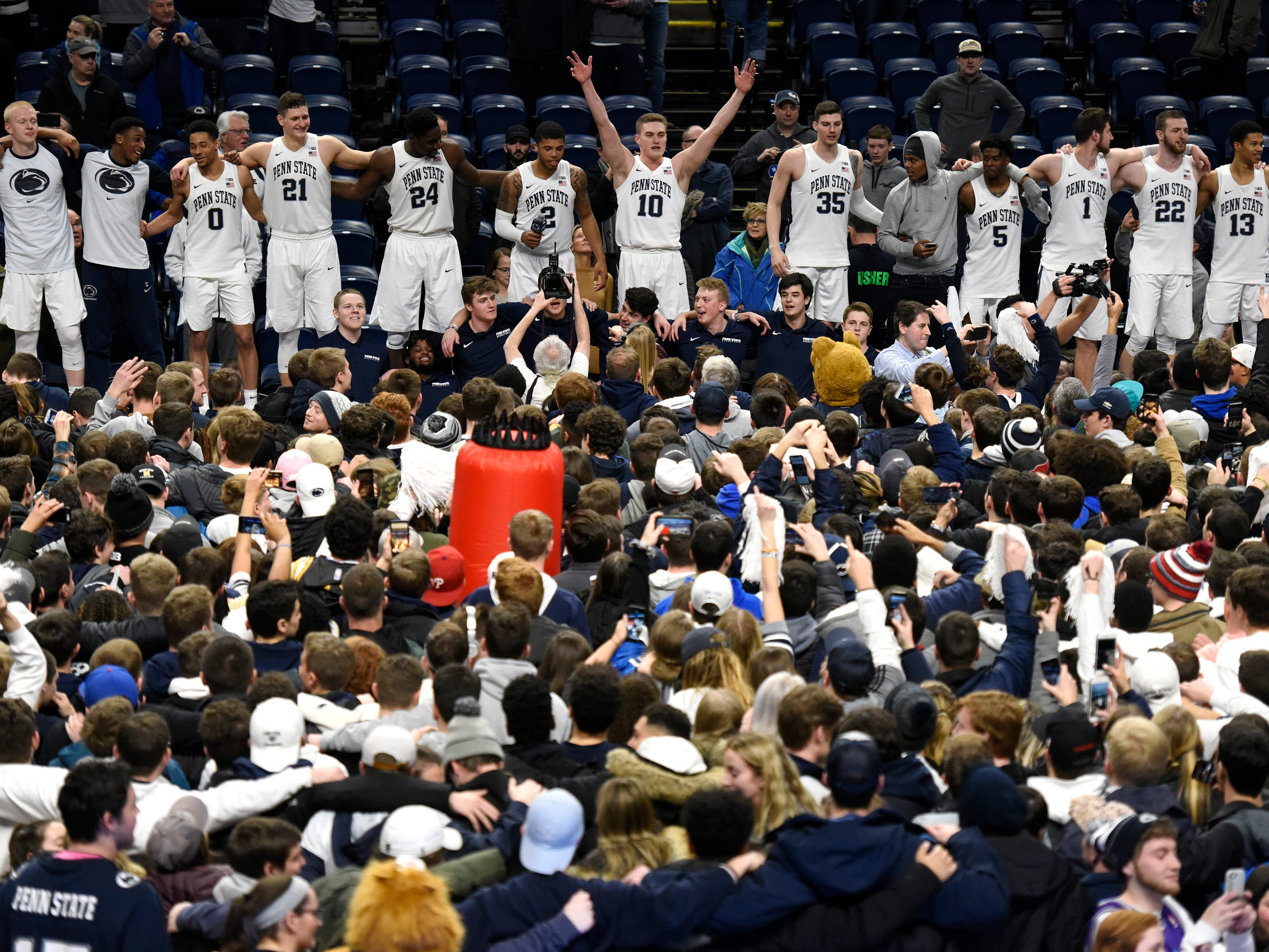 Penn State players celebrate their 75-69 upset win over Michigan, Tuesday, Feb. 12, 2019, in State College, Pa.
