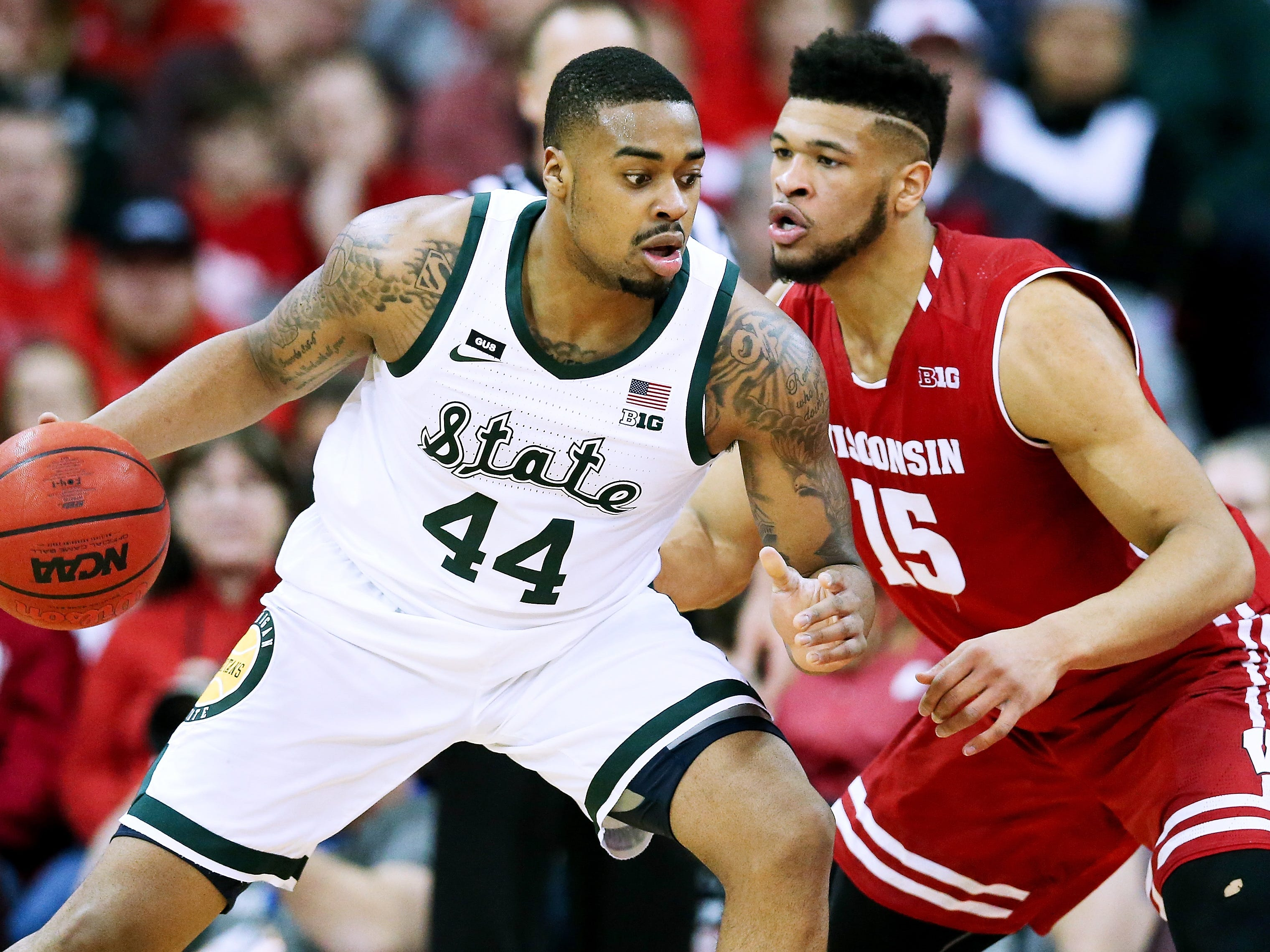 Michigan State's Nick Ward dribbles while guarded by Charles Thomas IV of Wisconsin in the first half at the Kohl Center on Feb. 12, 2019 in Madison, Wis.