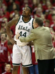 Nick Ward listens to Tom Izzo during the game vs. Wisconsin on Tuesday.