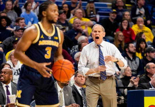 Michigan coach John Beilein yells to guard Zavier Simpson during the first half against Penn State at Bryce Jordan Center, Feb. 12, 2019 in University Park, Pa.