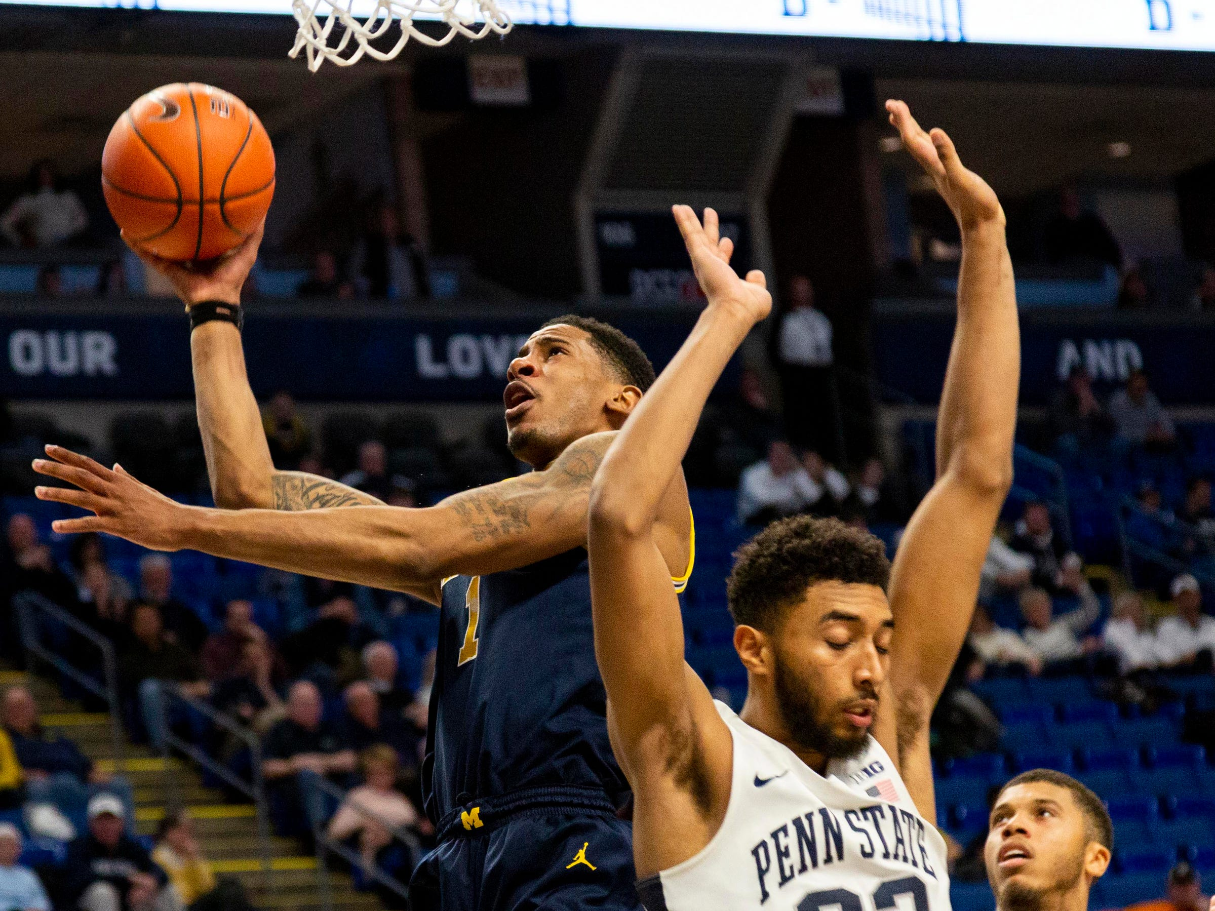 Michigan's Charles Matthews shoots over Penn State's Josh Reaves during the second half Tuesday, Feb. 12, 2019, in State College, Pa.