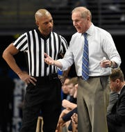 Michigan coach John Beilein pleads his case with referee Lewis Garrison during the first half against Penn State, Tuesday, Feb. 12, 2019, in State College, Pa.