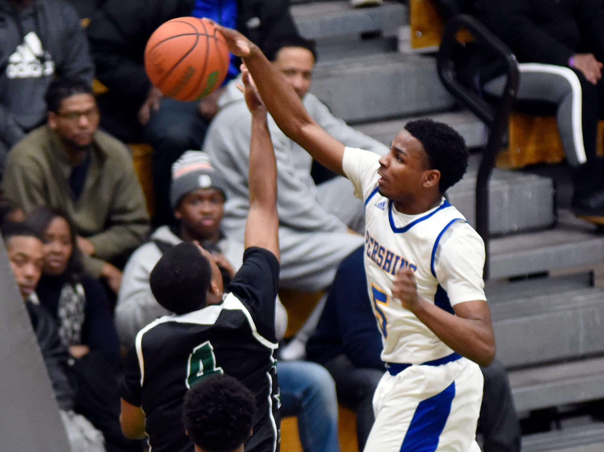 Detroit Pershing's Reggie Lawrence (5), right, blocks the shot of Cass Tech's Kyle LeGreair (4) during the second quarter, Tuesday, Feb. 12, 2019, in a PSL boys basketball semifinal held at Cass Tech HS in Detroit.  (Jose Juarez/Special to Detroit News)