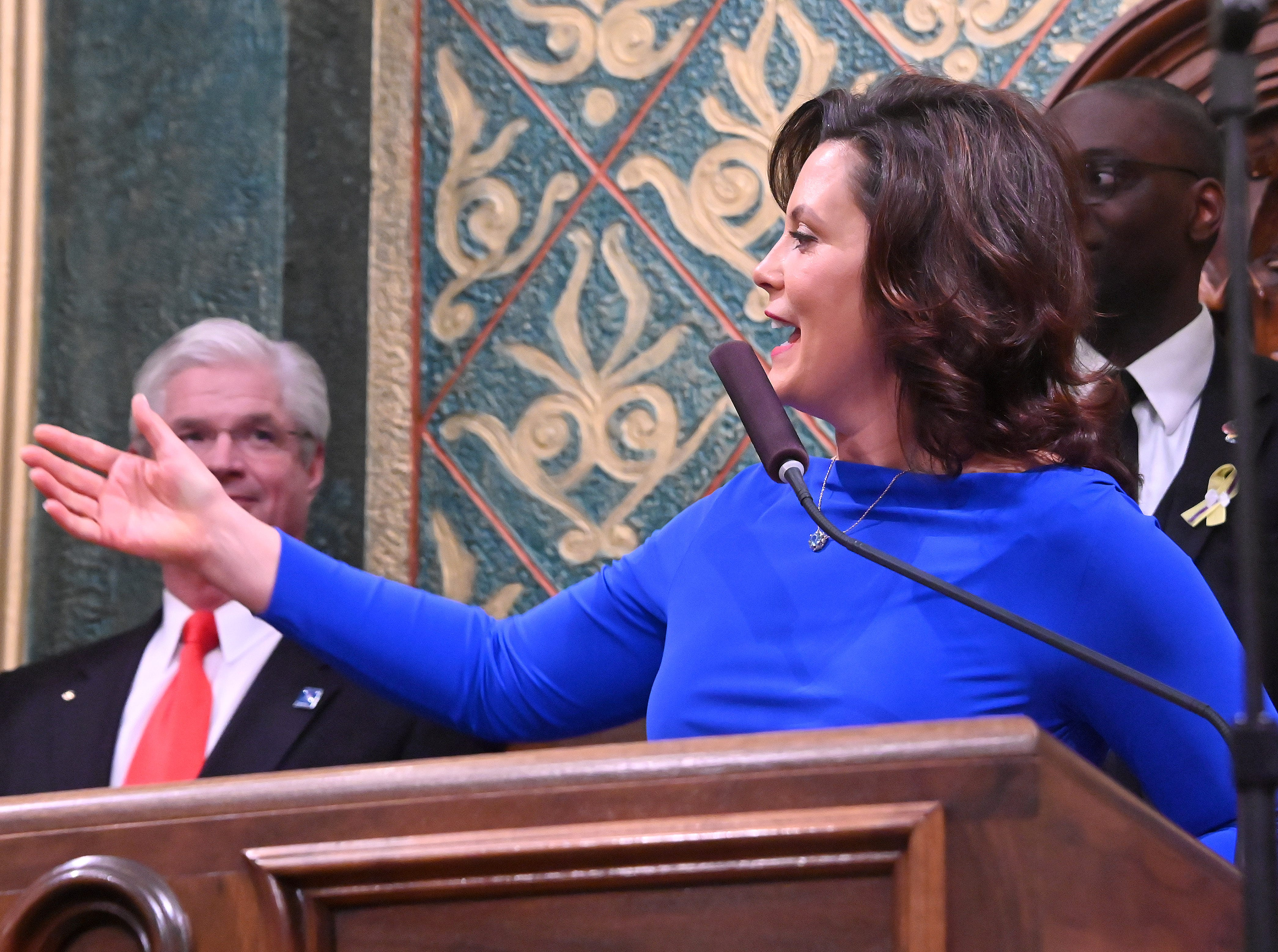 Gov. Gretchen Whitmer delivers her State of the State speech. Senate Majority Leader Mike Shirkey listens at left.