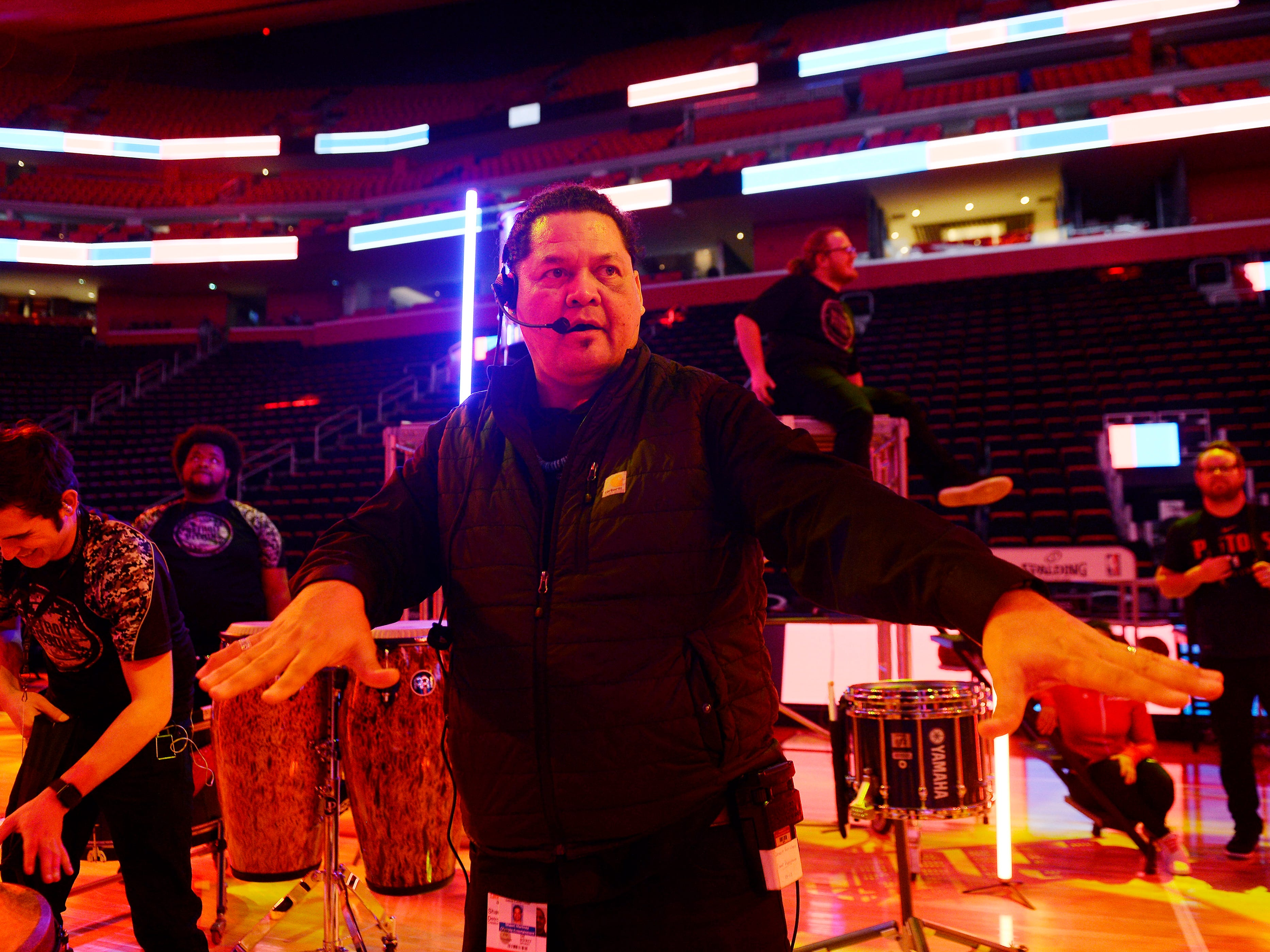 Shawn Martinez, entertainment director for the Detroit Pistons, directs the rehearsal for the halftime entertainment.